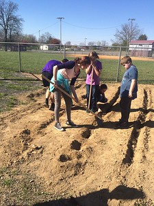 Coalmont Elementary students working on their new garden