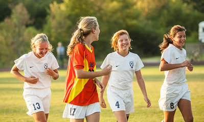 Members of the SAS middle school girls' soccer team celebrate another win