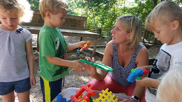 Sewanee Children's Center director Sandy Glacet plays with students at the school's playground