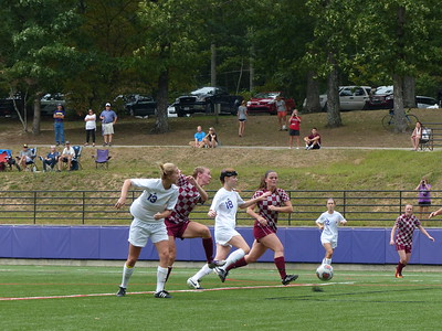 Sewanee's Tyler Edell (No. 13) and Erin Gill (No. 18) drive past the Transylvania defense 0n Sept. 17