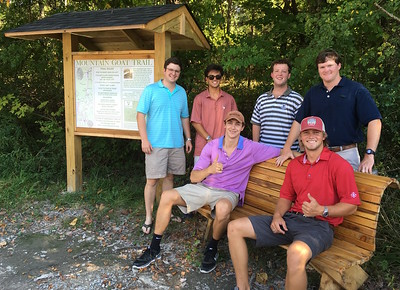Members of SAE fraternity at the University of the South with the bench they built for the Mountain Goat Trail. Photo by Patrick Dean