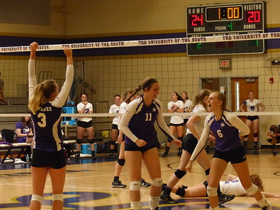 From left, Caroline Owens, Elizabeth Gill and Anna Wilson celebrate Sewanee volleyball's first conference win on Sept. 18. Sewanee beat Millsaps at home in four games. Photo by Lyn Hutchinson