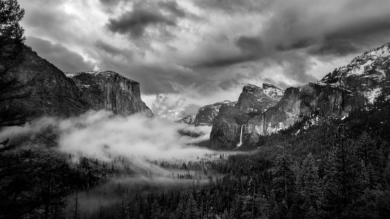 Clouds flow through tunnel view