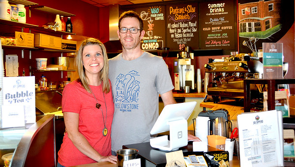 Christy and Kevin Hiatt, owners of Joe Sippers, stand behind the counter of the cafe Tuesday afternoon. The Hiatts will pass on ownership to Emily and Brennan Debenham. Kaitlin Cordes photo