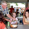 Bingo was one of several activities at this year's St. Mary of the Assumption 181st Annual St. Mary's Pre-Labor Day picnic held Sunday in Ste. Marie. Pictured from left, Bingo Money Clerk George Semple, Bingo winner Riley Tarr and her mother Amanda Tarr of Newton. Charles Mills photo