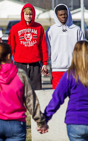 Effingham High School students hold hands in front of the school during a national walkout in mid March in response to the Parkland, Florida school shooting that left 17 dead in February. File Photo