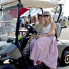 From left, Cedric Wright, Ruth Wright and Jessica Wright, dressed in period clothing, coast around in a golf cart at the Dieterich 125th Celebration Saturday evening. Kaitlin Cordes photo