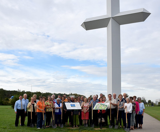 A large group of volunteers, donors and board members were present for the symbolic groundbreaking for the new enhancements coming to the grounds at the Cross at the Crossroads Monday afternoon. Kaitlin Cordes photo
