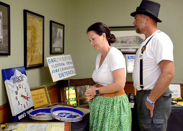 Brandi and Rodney Lidy browse items in the museum hosted at the Dieterich Civic Center as a part of the 125th Celebration Saturday evening. Kaitlin Cordes photo