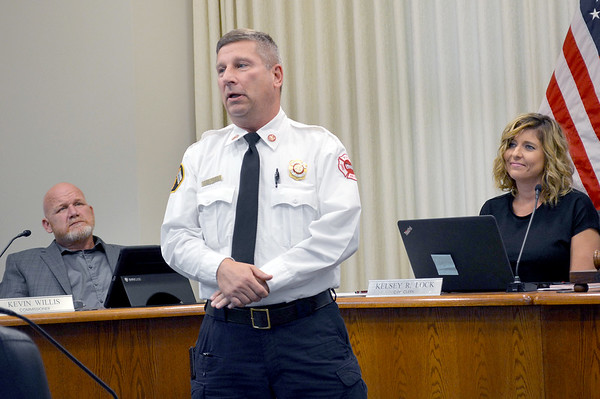 Bob Tutko who has served as the interim Effingham Fire Chief since August was named as the replacement for fire chief on Tuesday. He is flanked by Commissioner Kevin Willis and Interim City Administrator Kelsey Lock. Dawn Schabbing photo
