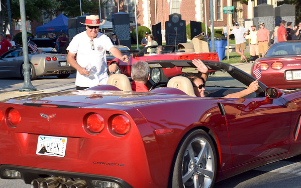 Mid America Motorworks 25th annual Corvette Funfest kicked off with a Welcome Party downtown Effingham on Thursday. Shown here is lead cheerleader Mike Yager giving a fist bump to a visitor to the event. Dawn Schabbing photo