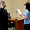 Effingham Interim Fire Chief Bob Tutko takes the oath of office as he begins his term effective Wednesday. Presenting the oath is Effingham Deputy City Clerk Abbey Nosbisch. Dawn Schabbing photo