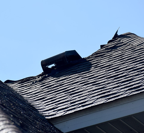 A damaged portion of the roof on the Allred home is shown Tuesday after a lightning strike caused an attic fire at the home in the Lake Edwards subdivision. Kaitlin Cordes photo