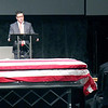 Chris Guffey speaks at the funeral of his father, Effingham County Coroner Duane Guffey, during a service honoring Guffey's life in late February. File Photo