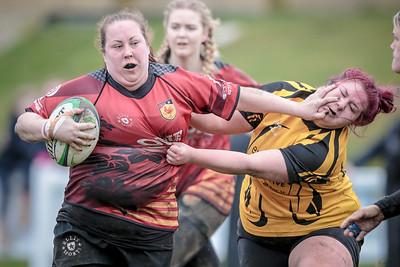Sarah Kemp hands off an Amber Valley player