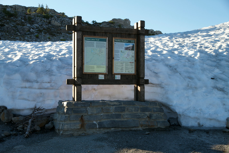 Snow piled up behind the trailhead sign