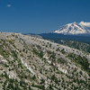 Devastated hills near Mt. St. Helens, with Mt. Adams in the distance.  Mt. Adams is a similar large and potentially active volcano in Washington state