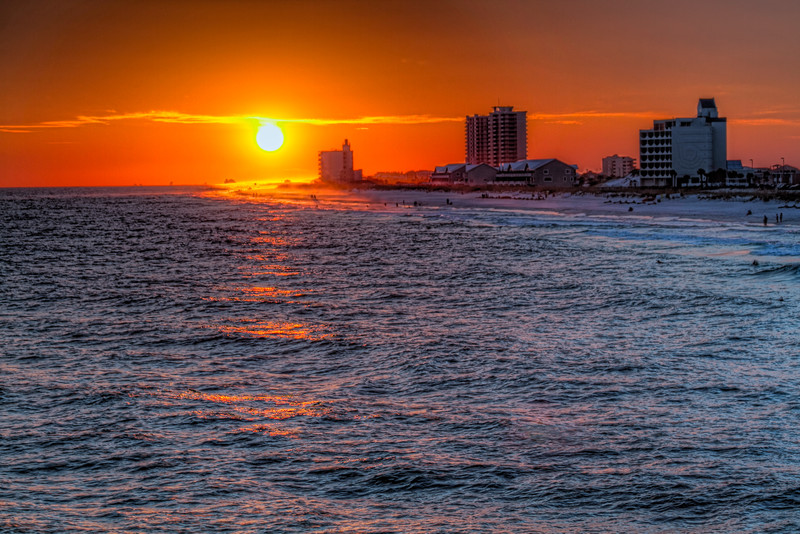 Just before my family's last vacation, I was able to pick up a new telephoto lens. It was just in time to break it in on some sunsets and sunrises on Pensacola Beach in Florida. This sunset is looking towards the Gulf Islands National Seashore, a large preserve on the west side of the island and home of Fort Pickens, far past the high-rise condos. Photo by Tim Stanley Photography.
