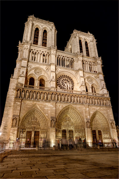 Notre Dame at Night<br /> As interesting as old stone buildings are, at night, they all seem to have a similar tone. What sets them apart is the architecture itself. Notre Dame in Paris is one of those buildings that looks incredible no matter when you see it, at noon or at midnight. The detail in the stone carvings and the sheer size of such a building built during it's time are just a few reasons to appreciate it.