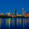 Austin Skyline<br /> It had been a rainy week as we attended the South by Southwest Conference in Austin earlier this month. It wasn't a great week to carry the camera, so it spent much of the time in the hotel room. I was determined to take a few shots though, and did manage to spend the last two evenings out looking for something interesting. On the last evening we made it to the river, just at sunset.<br /> My first shots from a pedestrian bridge had too many foreground distractions, so I headed for the river's edge and found a flat spot with a nice view. It was a great way to end the week.