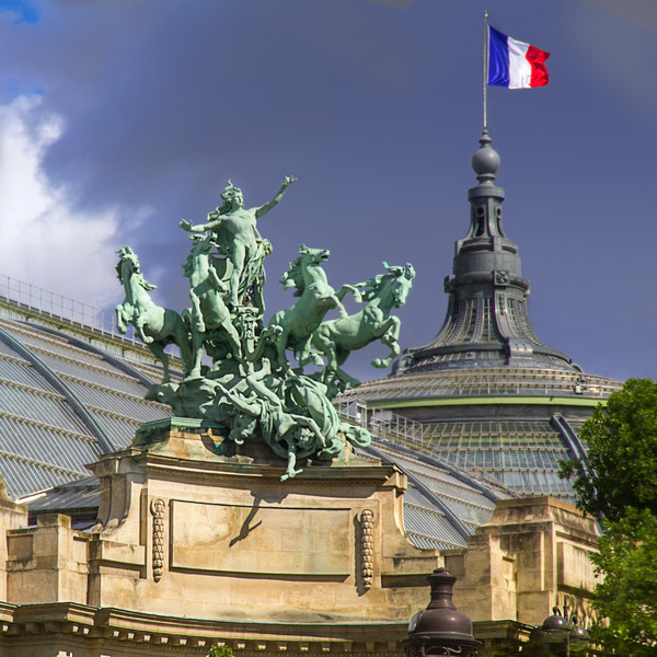 The Horses of the Grand Palais<br /> Atop the two corner entrances to the Grand Palais you will find a Quadriga, or a chariot drawn by four horses abreast. They are the the work of French sculptor Georges Récipon, created around 1900. Each entrance is concave, with the quadriga rising a hundred feet above street level. This copper quadriga on the Seine side, Harmony Triumphing Over Discord, weighs 12 tons, yet seems to defy the law of gravity as the horses leap into the air.
