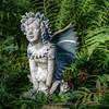 Garden Angel<br /> This little garden angel stands watch in a patch of fern at my friends house on the lake, not far from the Blue Frog on a Post.