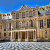 "The Interior Court of the Palace of Versailles<br /> One of the pleasures of owning a home is walking out to the back porch to rest a spell. Away from the noise and traffic of a busy street, it's a place of refuge. There are regular size back porches and then you expand to courtyards. From there they just graduate to ""courts"". The previous occupants of the Palace of Versailles had no lack of places to relax. How about a court that looked upon almost 50 statutes lining the walls and roofs?  Toss in a little gold ornamentation along the roof and it could almost feel like home."