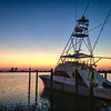 Shaggy's Sunset<br /> The weather in Florida was great, but the sunsets were cloudless, so I stayed in with the family most evenings. On this evening, we went to dinner at a local seafood restaurant called Shaggy's. I purposefully didn't bring the camera, but when I saw this scene, I had to detour and pull out the iPhone for a quick photo. If you visit Shaggy's, make sure you go at sunset and eat on the patio, as it overlooks a small harbor. I highly recommend the crab cakes.