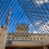 Beneath the Lourve<br /> The Louvre Pyramid (Pyramide du Louvre) is a large glass and metal pyramid, surrounded by three smaller pyramids. Located in the main courtyard (Cour Napoléon) of the Louvre Palace (Palais du Louvre) in Paris, the large pyramid serves as the main entrance to the Louvre Museum. Completed in 1989, it has become a landmark of the city of Paris.<br /> Next to the Eiffel Tower, it is one of the most popular items to photograph while in Paris. Because of our very short visit, I couldn't compete with the beautiful shots of the pyramids outside, so I thought I would try a different twist by shooting from underneath.