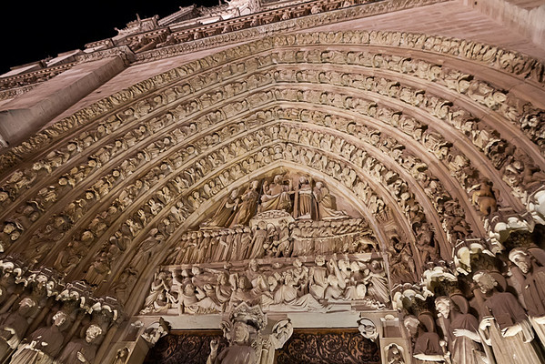 Notre Dame Archway<br /> These carvings show a multitude of angels surrounding Christ in the center of the arch, above the doorway at the Notre Dame Cathedral in Paris.