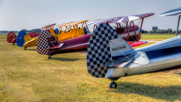Rudders in a Row<br /> This colorful lineup of Steerman biplanes is from the 2012 Stearman Fly-In in Jennings, Louisiana.