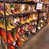 Boots, Boots and More Boots<br /> There's one thing you can always count on at a rodeo, and that is lots of boots. Boots on the cowboys, boots on the cowgirls and those that want to be (or at least pretend for the weekend).<br /> I grew up in boots in high school, but gradually stopped as I got older. In the Houston heat, it just doesn't make sense sometimes. So like a lot of folks, I pull them out, polish them up and slap them on for rodeo time. I bet you have a pair in the closet somewhere too.<br /> These children boots come in all sizes and colors at the Houston Livestock Show and Rodeo.