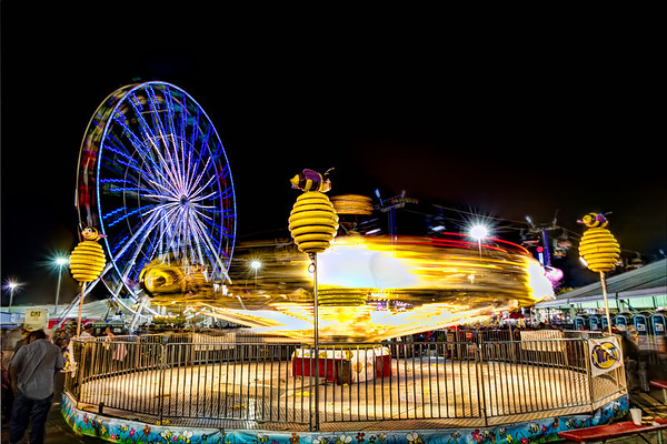 The Bumblebee Blur<br /> If you have ever want to try you luck at night time photography, make your way to the nearest carnival. The lights, movement and rides guarantee you will walk away with something that will surprise and please you. Don't forget your tripod though, since you want the stationary objects to look stationary.