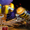 "The Bumblebee Bounce<br /> It was a long day at the rodeo and I was about to leave. I never actually saw the rodeo, but opted for the vendor area, livestock show and carnival. I figured there was enough to shoot there and I was right. I was leaving and turned for one last look and saw the ferris wheel through this ""bee"" ride and thought I might try some motion effects. This one had just enough blur to see what it was, while still looking like it's moving."
