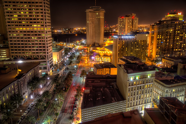 Canal Street at Night<br /> One of the things I enjoy about staying at a downtown hotel is the view. Not having ever worked in a tall office building, I always enjoy going up high and looking at a city from above. This view is from the Sheraton hotel in downton New Orleans, looking down Canal Street towards the Audubon Aquarium of the Americas by the Mississippi River. This is one of those photos you want to click on to see a higher resolution version.