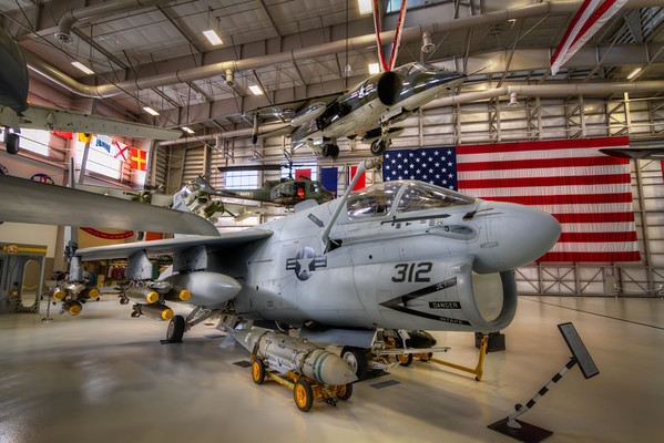 A7 Corsair II<br /> The Corsair II was used in the United States Navy during the Vietnam War and Dessert Storm. This VA-46 on display at the National Naval Aviation Museum flew over 30 strike missions in Dessert Storm. Floating above the Corsair is the Harrier Jump Jet, the first operational close-support and reconnaissance fighter aircraft with vertical/short takeoff and landing (V/STOL).