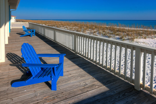 A Little Piece of Heaven<br /> I've come to appreciate the soft breeze, relaxing sound of the surf and a nice deck to kick back and rest, like this large deck with the two blue chairs.
