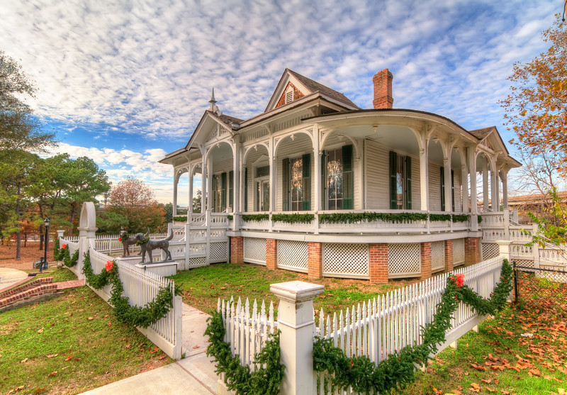 This Eastlake Victorian style home was built by Eugene Pillot in 1868. It quickly became a local landmark in Houston, because of the house's architectural charm and partly because of the dog sculptures. Photo by Tim Stanley Photography.