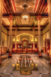 Check-in desk of the Driskill Hotel I had just finished my first photo walk. What an experience. It was the Trey Ratcliff Photo Walk in downtown Austin, TX during the SXSW 2011 Conference. We had just returned to the lobby of the historic Driskill Hotel and I was waiting with some other folks to meet Trey and hopefully get a photo with him. Since the tripod was still open, I shot this while waiting in line. 3 image HDR