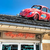 Capt'n Fun<br /> Sometimes you see something out of context and you have to blink and look again to see if you saw what you think you saw. Imagine the first time I saw a Volkswagon sitting atop a roof. Such is the case on this island shopping area in Pensacola. Souvenir shops  come up with all kinds of ways to draw the customers and this tactic seems to work pretty good.