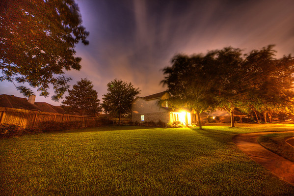 Learning Something New<br /> The more you work at a hobby, the better you get  (hopefully). This is one of my early attempts last spring trying HDR photos. HDR, along with nighttime exposures, brought out details that the eye alone can't see. A wide-angle lens make this yard look larger than it really is, plus the movement of the clouds during the exposure gives the sky a surreal feel.<br /> <br /> Maybe it's the unexpected surprises like this that I enjoy so much about HDR and nighttime photography.