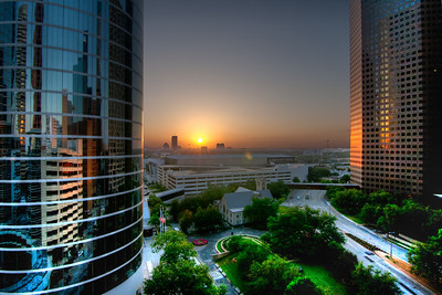 Sunset Between the Towers Downtown buildings make good subjects for backdrops in sunsets. My very first photo walk in downtown Houston started with a stop at the top of a parking garage at just the right time. This photo demonstrates a benefit of high dynamic range photography; the reflections in the buildings were not visible on the standard photos, but only became apparent when the image was processed.