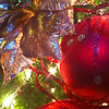 Holiday Glitter<br /> We were waiting for a table last night at a restaurant and were standing by their Christmas tree. Having just my iPhone, I thought I might chance a few photos. I'm sure a few folks thought I was silly for shooting an ornament, but I thought it turned out okay.