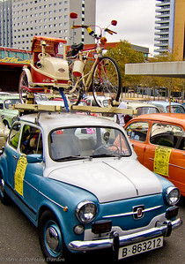 """SEAT 600 rally in front of Museum of Natural Science.  Many of the tiny cars are outfitted for a """"weekend in the country"""". Like this one with bicycle + sidecar."""