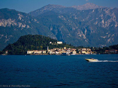 Bellagio is situated at the tip of the peninsula separating Lake Como's two southern arms, with the Alps visible across the lake to the north.