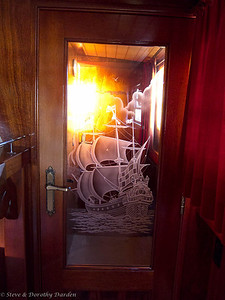 Glass carving on the door leading to our forward 'First Class' cabin