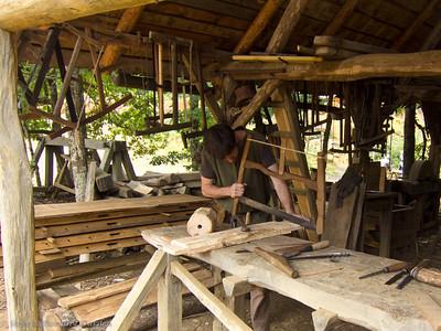 Traditional hand tools are used for carpentry.