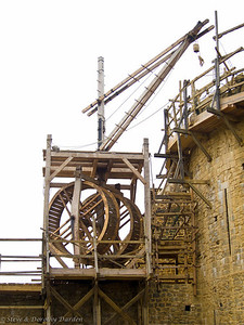 Human-powered wheels were being used to lift stones to the construction at the top of the tower.