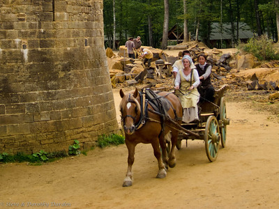 Quarry in the background, as horsecart rounds the tower wall.