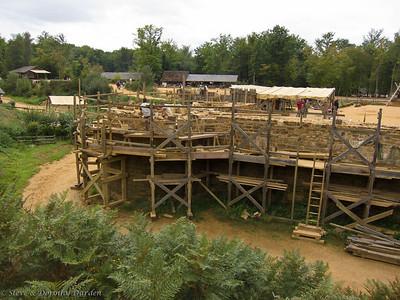 Masons at work building a wall